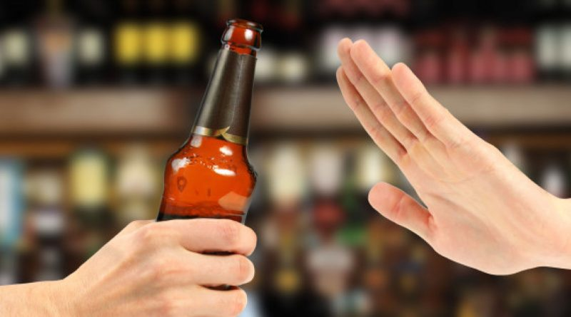 hand reject a bottle of beer in the bar (both images are my property)