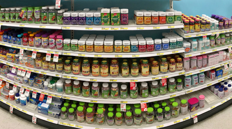 Alameda CA - October 16 2017: Grocery store shelf with bottles of various brands of vitamins and supplements. Multivitamins were found to be the most commonly used supplement