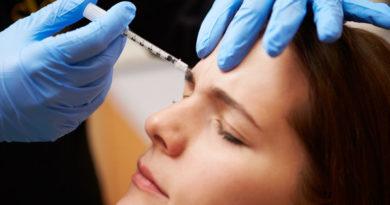 31066824 - woman having botox treatment at beauty clinic